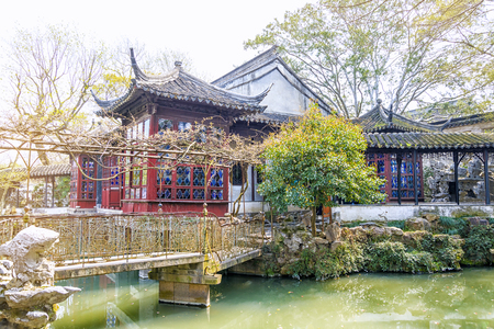 Classical picturesque Chinese garden with pavilions and ponds in the city of Suzhou in the spring, China Фото со стока