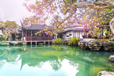 Classical picturesque Chinese garden with pavilions and ponds in the city of Suzhou in the spring, China Foto de archivo - 126141695