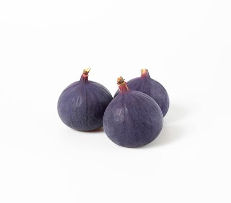 Fresh figs isolated on white background. Food Photo. Purple Fig with closeup. Side view.