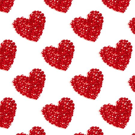 Seamless pattern with red hearts on a white background. Shiny hearts made of beads. Valentines day concept. Valentines day or mothers day background.