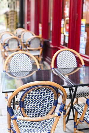 Cafe on the street of Paris. Good day for a walk. Tourism and comfort in Europe