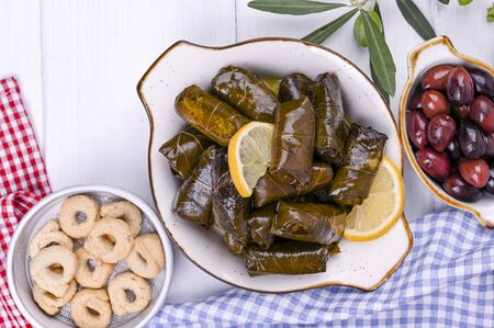 Turkish cabbage rolls and various snacks of national cuisine. Rice in grape leaves and olives. Food for a traditional oriental lunch