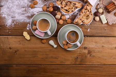 A traditional Dutch holiday for children of Sinterklaas. Winter holidays in Europe and the Netherlands. Stollen with cranberries and icing sugar. A form for writing text and aromatic coffee.