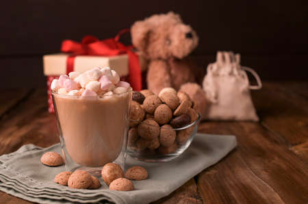 Dutch holiday Sinterklaas. Fragrant black coffee and and cocoa with marshmallows , traditional hollands sweets. Concept for children party Saint Nicholas day five december. Copy sapce. Zdjęcie Seryjne