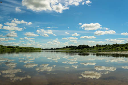 Beautiful Landscape with reflection on River Sky and Clouds.