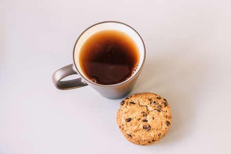 Autumn tea. Sweater, maple leaves, cookies and cup of tea with lemon. Cozy fall season. Foto de archivo