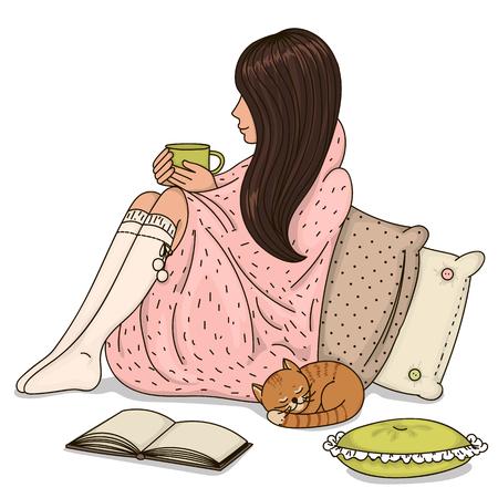Chica sentado envuelto en una manta y que sostiene la taza