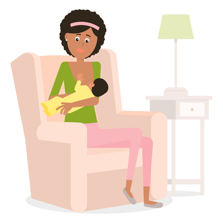 breastfeeding: A young African-American mother breastfeed.