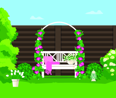 Back yard with an arch of flowers and a bench on the background of a fence.