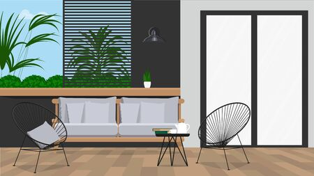 Garden furniture on the background of the wall with plants.