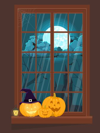 Window decorated for Halloween with pumpkins.