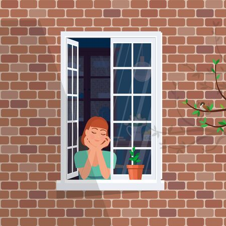 The girl in the window dreams and basks in the spring sun.