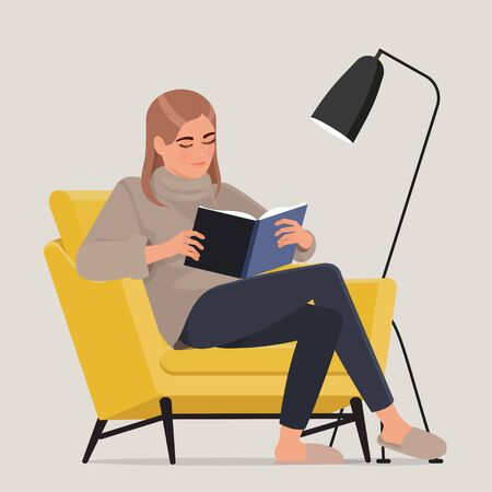 Girl in a yellow armchair reads a book