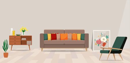 Cozy living room with beige sofa and cushions, green chair and a painting on the floor.