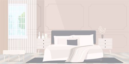 Cozy beige colored blanket on king size bed in bright bedroom