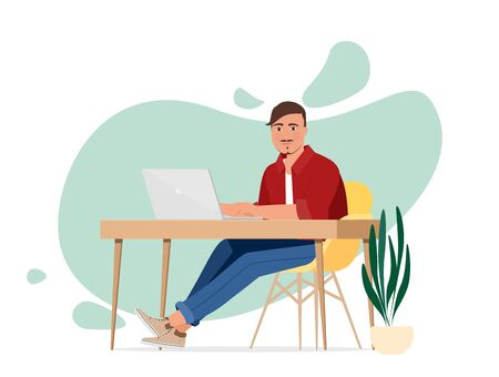 The man at the desk with a laptop. Freelancer or office worker. Vettoriali