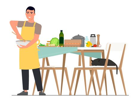 A smiling man in a yellow apron is preparing food against the background of a food table and a sleeping cat in a chair.