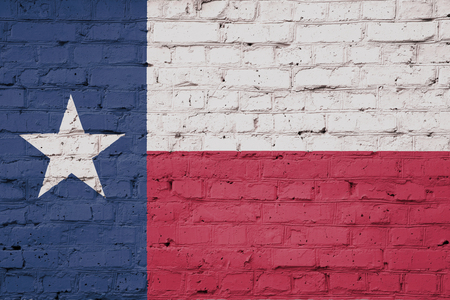 Texture of Texas flag of on a pink brick wall. Stock Photo
