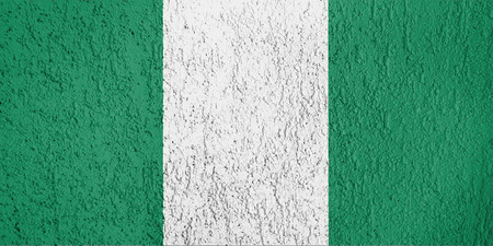 Texture of Nigeria flag on the wall of relief plaster.