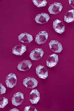 Large diamonds on a maroon background.