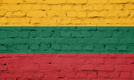 Texture of flag of Lithuania on a brick wall.