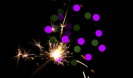 Blurred green and purple lights (new year texture). Imagens