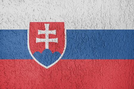 Texture of Slovakia flag on the wall of relief plaster. Standard-Bild - 134866794