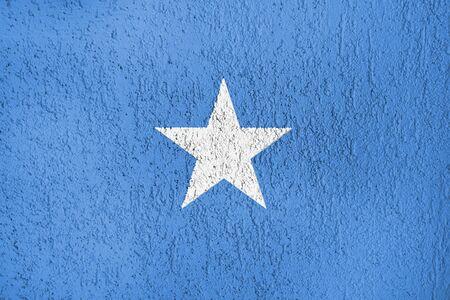 Somalia flag of a white wall of plaster. Standard-Bild - 134866795
