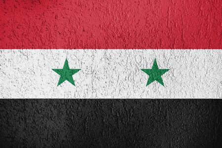 The Syrian flag is on the wall of the plaster.