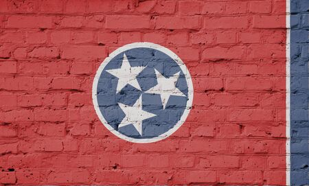 Texture of a flag of Tennessee on a pink brick wall.