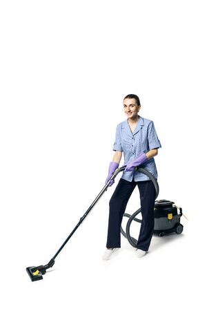 Young beautiful woman in a maid costume smiling and getting ready for vacuuming, isolated Standard-Bild - 139814300