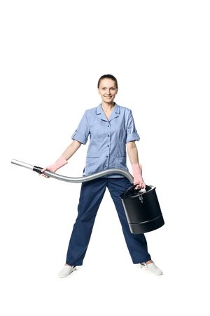 Young beautiful woman in a maid costume smiling and getting ready for vacuuming, isolated Standard-Bild - 139814342