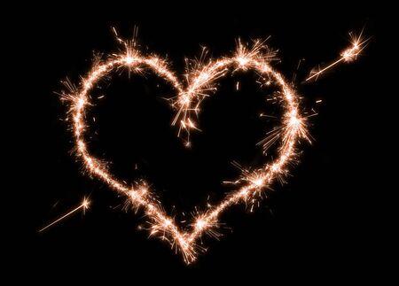 Sparklers heart on a black background.