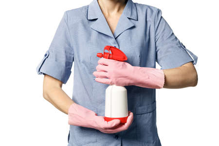 Female maid hands hold spray for washing windows isolated on a white background Stock fotó