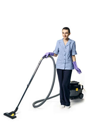 Young beautiful woman in a maid costume smiling and getting ready for vacuuming, isolated on a white background.