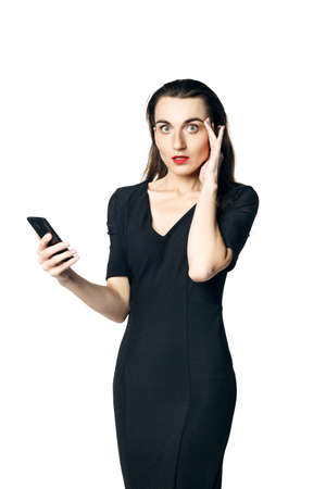 Business woman (fatal woman) in a black dress with red lipstick talking on the phone, isolated on a white background
