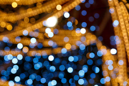 Blurred gold and blue bokeh texture. Multicolored circles
