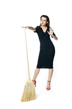 The girl in the black dress says no to the broom, stop clean.