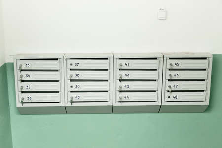 New mailboxes with keys at the entrance. Standard-Bild