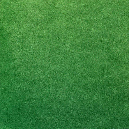 Texture of green shiny background with glitter
