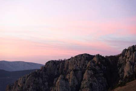 Evening mountain landscape, sunset pink-purple sky of Demerdzhi