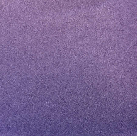Texture of purple shiny background with glitter
