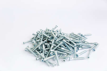 A slide of screws for furniture on a white background