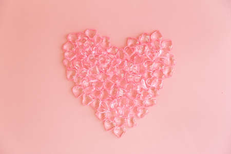 Heart made of many small pink hearts on a pink background Standard-Bild