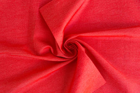 Dense red fabric coiled texture. Standard-Bild