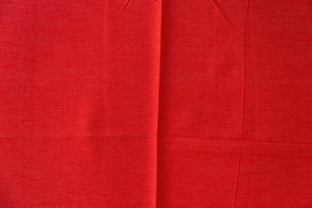 A Crumpled red fabric texture.