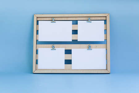 Frame on a light blue background with a place for signature on a white blanks. Standard-Bild