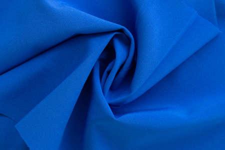 Dense blue fabric coiled texture.