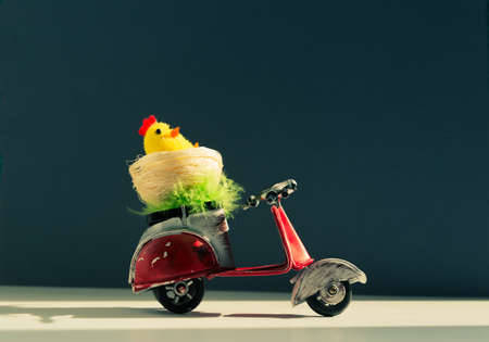 Chicken toys in a basket on a scooter.