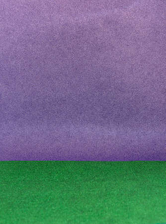 Texture of purple and green shiny background with glitter.